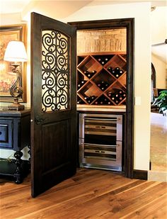 coat closet converted into a wine closet. Mine as well! All of our wine is in the closet anyway! Love the door.