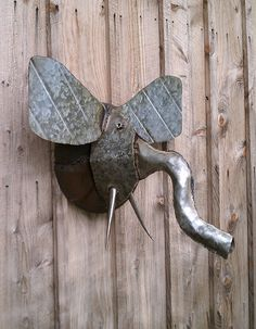 Elephant Trophy Head Wall Sculpture Reclaimed Farm Metal. $340.00, via Etsy.