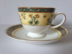 Wedgewood fine bone china cup and saucer; India design.  Beautiful India design leigh shape footed tea cup and matching saucer by Wedgewood.  Fine bone china, in lovely vintage condition.  Decorated with a fine floral theme and finished with a 22 karat gold trim.  Boxed.  Discontinued line; ideal for anyone looking for replacements.  Teacup approximately 6.5cm (2.5) height, 8.5m (3) diam. Saucer approximately 8.5cm (3) diam.  Please note that international courier rates rates fluctuate…