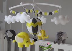 With MUSICAL CRIB ATTACHMENT. Grey yellow and white by BabyBeansNZ