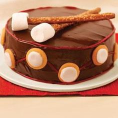 """Drummer Boy Cake Recipe.  Love the idea of the pretzel rod & marshmallow """"drum sticks"""".  Could do for Christmas; or musical themed birthday party; or recital, concert, or performance celebration."""