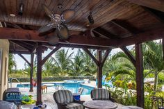 Wrap-around custom timber frame patio from Cayman Structural Group. Grand Cayman Island, Cayman Islands, Swimming Pool Designs, Swimming Pools, Construction Services, Custom Homes, Luxury Homes, Pergola, Relax