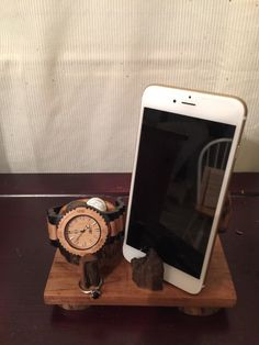 A personal favorite from my Etsy shop https://www.etsy.com/listing/258800437/driftwood-cellphone-docking-station-ring
