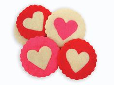 We colored our No Fail Sugar Cookie dough with red and pink food color and then stamp circles and hearts from the dough. Replace the center heart in cookie with an alternating color and bake.  http://www.fancyflours.com/product/Cookie-Cutter-Round-Set-of-5-Double-Sided/s