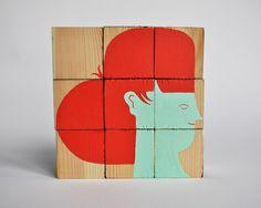 faces on wooden blocks