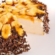 An impressive cheesecake topped with shaved chocolate.. Dream Banana Cheesecake Recipe from Grandmothers Kitchen.