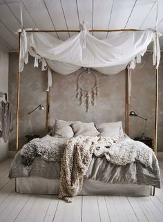 Romantic Boho bedroom - canopy bed w/ bamboo sticks, chunky cream and beige knit blankets and cushions, bedding in washed linen (hva)