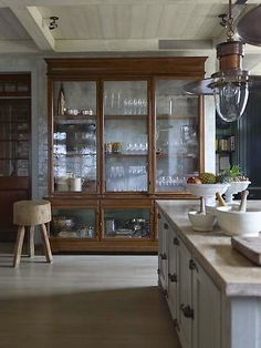 For storing all those plates, platters... a large, glass fronted, good looking cupboard, placed conveniently in the kitchen or dining room.