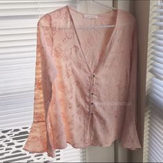 Embroidered Blush Pink Bell Sleeve Blouse little boho top, this would be it. Features a beautiful detailed embroidery and bell sleeves.  Fully functional button front  Flare sleeves  100% Polyester  Colors: Baby Blue, Blush Pink  Boxy, loose fit. Tops Blouses