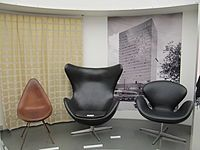 Arne Jacobsen -  Drop, swan and egg chairs designed by Jacobsen for use in the SAS Royal Hotel - pictured in background