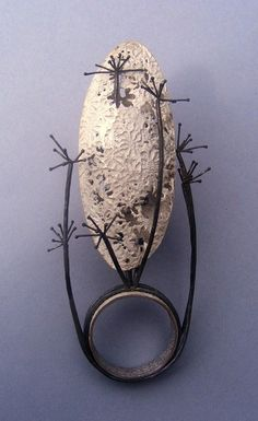Nicola Mather -  silhouette ring 2...... Connie Fox: Protruding wires often get my vote for edgy.
