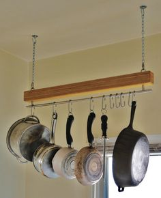 This minimalist design works great for tight spaces and includes (10) sliding stainless steel hooks that allow you to arrange pots and pans freely.