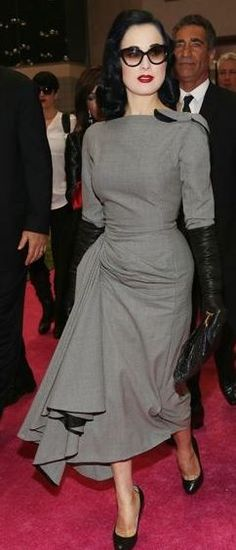 Love the simple colours of black & grey - the detail on the skirt & shoulder, with the addition of the gloves, makes it interesting. Dita Von Teese in Galliano.