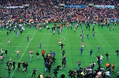 Stoke fans invade the pitch after their team wins promotion to the English top flight for the first time in 23 years, Stoke-on-Trent, 2008The pitch invasion at Stoke City after promotion, with Richard Cresswell at the centre on his knees in an act of supplication. Photo: Tom Jenkins for the Guardian
