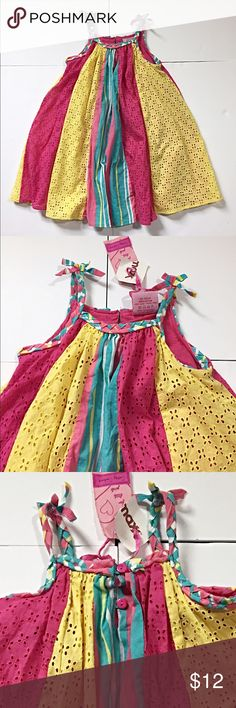 """🆕Listing: NWTs! Adorable Little Girl Sundress NWTs! Adorable Little Girl Sundress by Cutey Couture. Has alternating panels in 3 colors to create a full dress. Yellow and pink are eyelet lace. It is fully lined in hot pink. Size 2/3 years measures: 12"""" across chest, 21"""" long. 100% Cotton. Org price $21. 309/100/0311217 Cutey Couture Dresses Casual"""