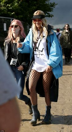 Fashion-forward: Rita Ora looked typically edgy in fishnet tights and an over-sized Louis Vuitton T-shirt
