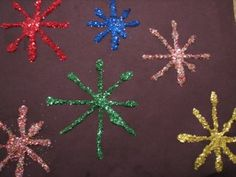 New Years Fireworks Craft. Use drops of paint and blow out through straws to make fireworks. Add glitter?