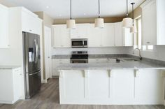 White Kitchen Cabinets with Beadboard Island | Lewis Custom Woodwork | Custom Cabinets | Northern Utah