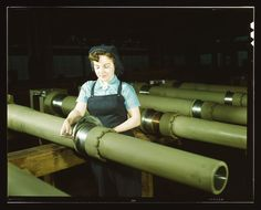 (Courtesy  |  Library of Congress) Mary Betchner inspects one of the 25 cutters for burrs before inserting it in the inside of a 105mm howitzer at the Milwaukee, Wis. plant of the Chain Belt Co. Feb. 1943.