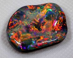 GORGEOUS VERY BRIGHT BLACK OPAL FROM LR - 7.40 CTS