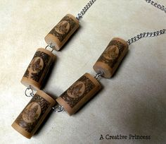 wine cork necklace- lots of wine cork ideas on this blog