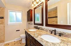 Shaker Heights OH Bathroom Remodel: Allen & Roth Double Sink Vanity matching mirrors & wall cabinet, Crystal Vanity Lights, Delta Oil Rubbed Bronze fixtures, Sandlewood Travertine tile flooring with Copper Rust Slate insets from the Tile Shop