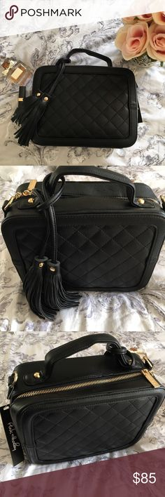 "SALE💕Black Quilted Box Satchel This bag is GORGEOUS and super high quality! Add a touch of luxe appeal to your daytime look with this quilted box satchel, which converts from a handsfree cross-body to a chic handbag! Vegan leather, but feels like buttery soft real leather! Inside features 1 middle Zip pouch, 1 zip wall pocket, and 2 slip-in wall pockets. Dimensions: 8"" H x 10"" W x 4"" D Materials: PU exterior, fabric lining.  Price is firm! Thanks Pink Haley Bags"