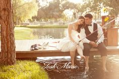 A fishing inspired styled wedding shoot.  Love the the bride and groom took off her shoes and are putting their feet in the lake.