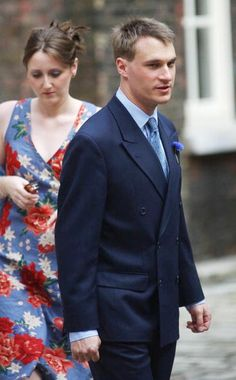 Alexander Windsor ,the Earl Of Ulster, with his wife Claire arrives for the wedding of his sister, Lady Davina Windsor at Kensington Palace on 31 July 2004