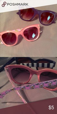 2 pair of cute sunglasses 2 pair of sunglasses one is blue with blue & white striped arms, the other is a pinkish color with paisley arms! Super cute!!! ALDO Accessories Sunglasses