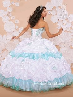 Unleash your fairy tale fantasies in the romantic Marys Bridal Princess 4Q372 quinceanera dress. This beautiful gown is fashioned in soft pastel hues. The exquisitely embroidered bodice is embellished with beads and is strapless with a sweetheart neckline and lovely lace-up back. The lush iridescent satin ball gown skirt is accented with beaded embroidery and showcases a split front organza, two-tone ruffled over skirt. The matching bolero features embroidered details and puff sleeves.