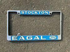 vintage original paint eagal ford stockton ca dealer license plate frame in 2020 license plate license plate frames plate frames pinterest