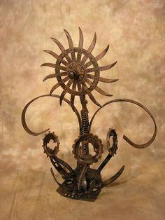 Recycled Farm Steel Sculpture by Chris Jaworski, via Behance