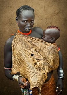 Africa   Bodi woman with her baby photographed in Hana Mursi, Omo Valley, Ethiopia   ©Eric Lafforgue