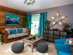 Property Brothers Jonathan and Drew Scott placed a giant lighted star above the credenza to provide soft lighting and a funky element to the bare wall.