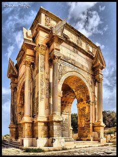 The Arch of Septimius Severus in the ancient city of Leptis Magna - Libya - early century AD - note the broken pediment - this is highly innovative and rare in Roman architecture of the period. Example of the Composite order of architecture. Architecture Antique, Classical Architecture, Beautiful Architecture, Beautiful Buildings, Art And Architecture, Ancient Ruins, Ancient Rome, Ancient Greece, Ancient History