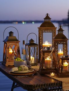 Candle light in ornate lanterns -a great way to dress your evening table Lanterns Decor, Candle Lanterns, Candles, Ramadan Decoration, Deco Luminaire, Candle In The Wind, Lantern Lamp, Oil Lamps, Fairy Lights