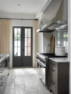 Like the more rustic feel of the floor paired with the modern clean lines of the cabinets and counters.