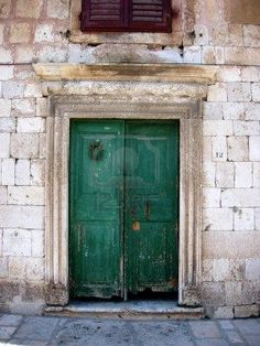 Love the thought of a green rustic door. Or blue maybe.