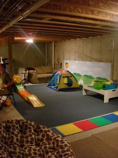 Thrifty Decor Chick: Our unfinished finished basement. Kid play area in unfinished basement.