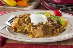 Enchilada Casserole           (18 Votes)  Share This Recipe        Print Notes Save to Recipe Box Rate & Comment SERVES 8 PREP 15 Min COOK TIME 25 Min READY IN 40 Min This Mexican casserole recipe with ground b