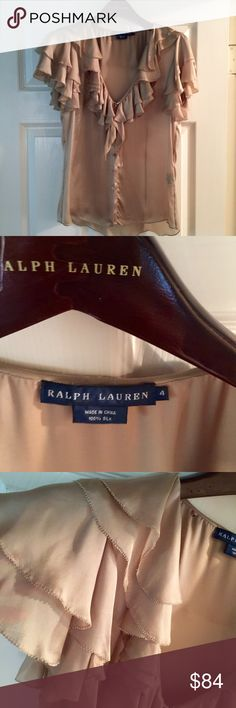 Ralph Lauren Top Ralph Lauren feather weight gold colored deep V-neck blouse.  Short sleeve silk top has multi-layered loose ruffles (not at all too frilly) around neck-line and at sleeve seam.  concealed mother of pearl buttons.  An elegant piece which would look great dressed down with white denim, or dressed up with a silk pencil skirt or palazzo pants.  Too small for me or I would keep it in my closet forever! Ralph Lauren Tops Blouses