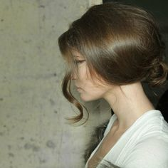 This relaxed updone updo is a sexy take on a traditional style. The loose curl at the front makes it look effortless.