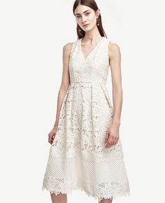 A Hint of Bridal: Many brides want an engagement party dress that feels bridal. Select a white lace sundress with a v-neck and a-line silhouette. Wear with a pair of flats and light, minimalist jewelry. White Lace Sundress, White Flare Dress, White Sleeveless Dress, Lace Dress, Engagement Party Dresses, Elle Blogs, Floral Frocks, Petite Outfits, Casual Outfits