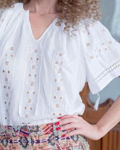 Delicate and ethereal, this exquisite ethnic blouse seduces with the alluring brilliance of natural silk, masterfully embroidered on white cotton fabric. Piece Of Clothing, Clothing Items, Folk Embroidery, Four Leaf Clover, Peasant Blouse, Elegant Outfit, Holiday Dresses, Pure White, Handmade Clothes
