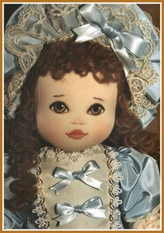 Marianne Cloth Doll by Kezi Matthews.  Lovely painted face.And just look how beautifully outfitted she is. Beautiful work.