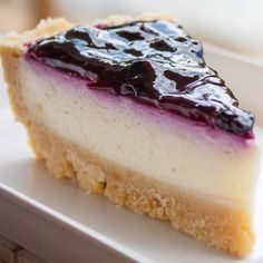 This creamy cheesecake recipe has a vanilla wafer crumb bottom, a simple cheesecake topped with a thin layer of sour cream and blueberry sauce.. Creamy Cheesecake Recipe from Grandmothers Kitchen.