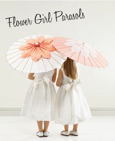 Your tiniest attendants will positively bloom thanks to these posy-topped flower girl parasols.