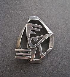 """A wonderful Salvador Vaca Teran design modernist bird brooch. May also be worn as a pendant. This Mexican silver brooch measures 1 7/8"""" tall and 1 1/2"""" wide. Design is pictured on page 132 of the book """"William Spratling and the Mexican Silver Renaissance."""" Marked with Eagle #3 and the initials ?MR which are surrounded by a circle that is impossible to read. Safety clasp. Nice weight and well made. Some very minor scratches. Great abstract design!"""