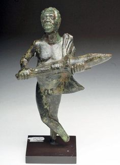 """Roman """"African Man""""Bronze Oil Lamp, Century BC/ADA very fine cast bronze lamp in the form of a standing African male. He stands nude save cape over his shoulder, anatomically correct, holding a. Ancient Rome, Ancient Art, Roman Artifacts, Art Antique, Roman Soldiers, 1st Century, Oil Lamps, Bronze Sculpture, Roman Empire"""